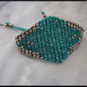 Adjustable silver and turquoise beaded bracelet